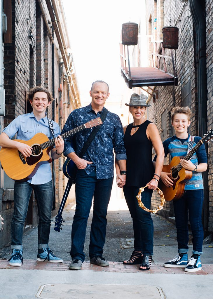 Fit Family Band standing in alley with instruments